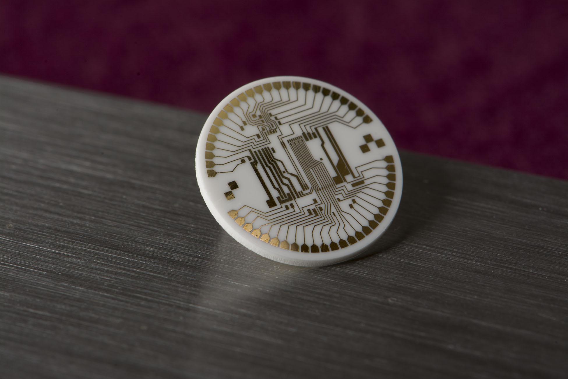 Laser machined thin film submount